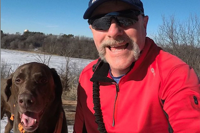 Clint Miller, Midwest Project Director, with his dog Zeke