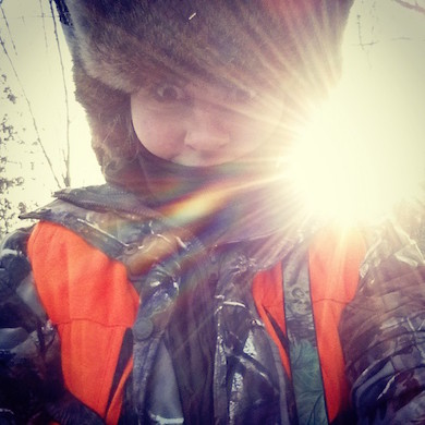 Emilee Nelson soaking in the sunrise while hunting.