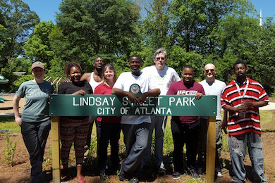 Shannon Lee joined by staff members from several grant recipients at Lindsay Street Park.