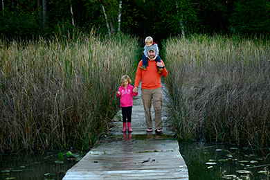 David Grusznski and his children at a 137-acre preserved site as part of the Milwaukee River Swamp. Photo by Ivan LaBianca.
