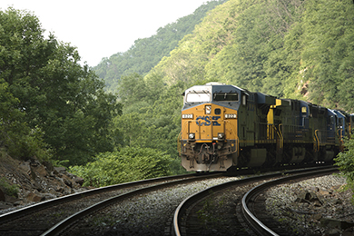 A CSX freight train carrying mixed freight through West Virginia.