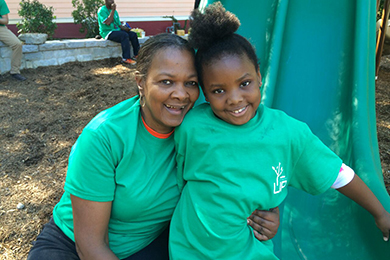 Mrs. Patricia Campbell and her granddaughter at the volunteer tree planting event before the grand opening of Lindsay Street Park. Photo by Shannon Lee.