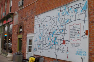 A map showing the Waterloo-Pickney Recreation Area hangs on a building in downtown Chelsea, Michigan. Photo by Kendra Briechle/The Conservation Fund.