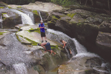 Kids enjoy the waterfalls at Pisgah National Forest. Photo by Keith T. Brown