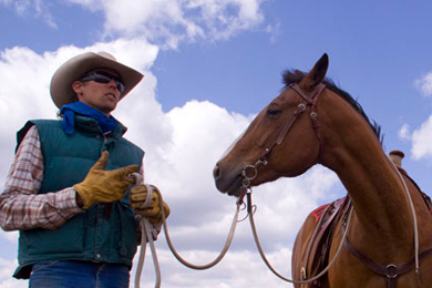 Freddie Botur with his horse on Cottonwood Ranches. Photo by The Conservation Fund